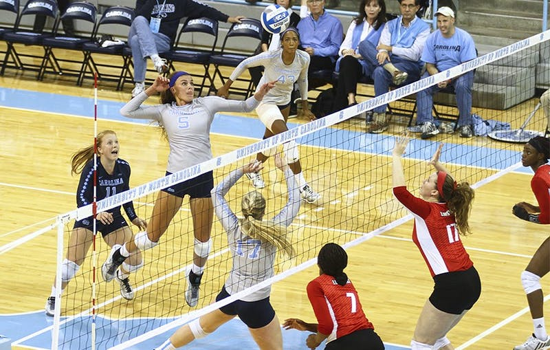 Tar Heel Paige Neuenfeldt (5) spikes the ball over the net against Louisville Friday night.