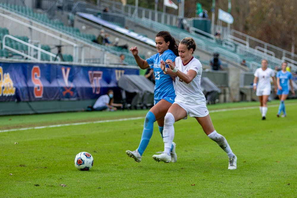 <p>UNC sophomore forward Isabel Cox (13) drives downfield against FSU junior midfielder Jailen Howell (6) in Sahlen's Stadium in Cary, NC on Sunday, Nov. 15, 2020. The Seminoles beat the Tar Heels 3-2 to win the ACC Women's Soccer championship.</p>