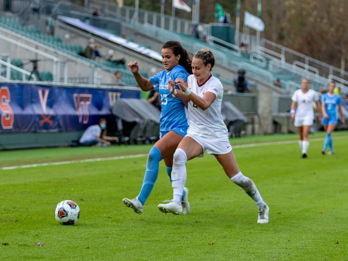 UNC sophomore forward Isabel Cox (13) drives downfield against FSU junior midfielder Jailen Howell (6) in Sahlen's Stadium in Cary, NC on Sunday, Nov. 15, 2020. The Seminoles beat the Tar Heels 3-2 to win the ACC Women's Soccer championship.