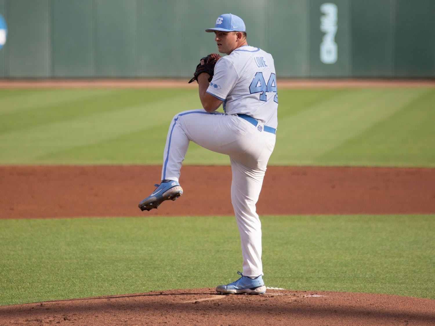 Redshirt sophomore Austin Love (44) prepares to pitch the ball in a game against Louisville on Friday, May 14, 2021. The Tar Heels beat the Cardinals 5-1.
