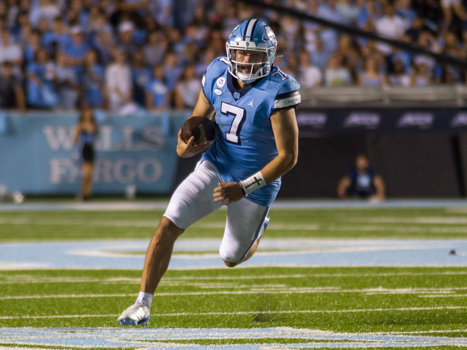 UNC junior quarterback Sam Howell (7) runs the ball down the field during the Tar Heels' home football matchup in Kenan Memorial Stadium on Sept. 18, 2021, against the University of Virginia Cavaliers. The Tar Heels won 59-39.