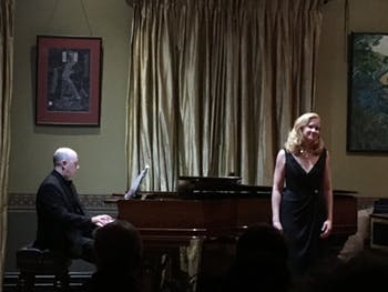 Martin (singing) and O'Brien (playing on piano) perform a recital inside O'Brien's home. Photo courtesy of Jessie Martin.
