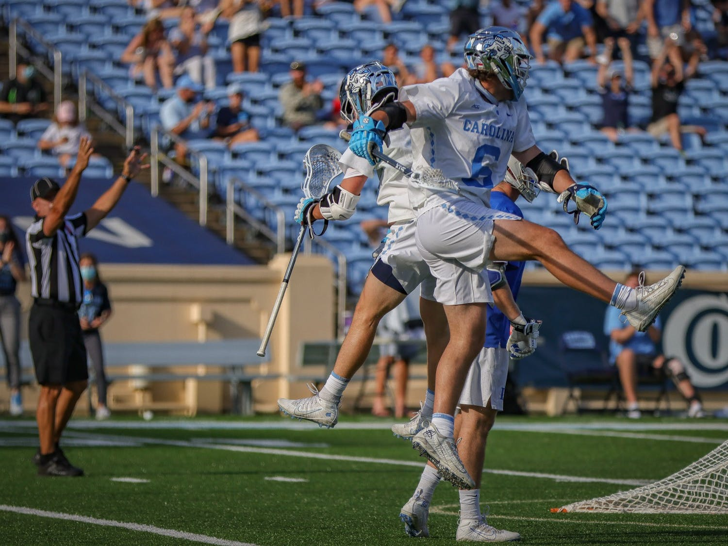 UNC sophomore attackman Lance Tillman (0) and freshman midfielder Cole Herbert (6) celebrate Herbert's fourth quarter goal during the Tar Heels' 15-12 victory against Duke on Sunday, May 2. With the victory, UNC and Duke share the 2021 ACC regular season title.