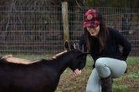 Lindsey Schwartz hand feeds goats at The 1870 Farm on Sunday, Nov. 25, 2018.
