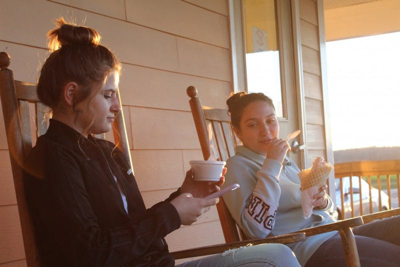 "Lital Sokolsky, 15 and from Cary, and Nika Shwartz, 14 and from Chapel Hill eating ice cream at Maple View Ice Cream on Sunday, March 17, 2019. Shwartz says ""why not make ice cream the NC state frozen dessert?"" Sokolsky says that ice cream is a good choice as the NC state frozen dessert because it's like the main frozen food."" Maple View Ice Cream is delighted to hear that ice cream could be the state dessert."
