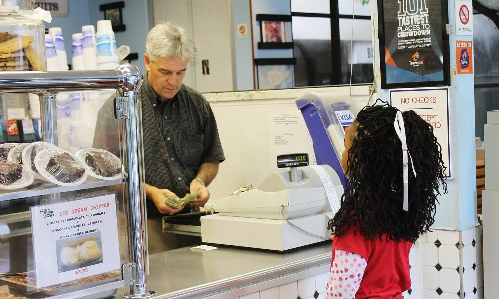 <p>Time-Out will soon have a food truck. Eddie Williams rings up third-grader Jayla Hines in the restaurant.</p>