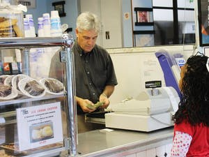 Time-Out will soon have a food truck. Eddie Williams rings up third-grader Jayla Hines in the restaurant.