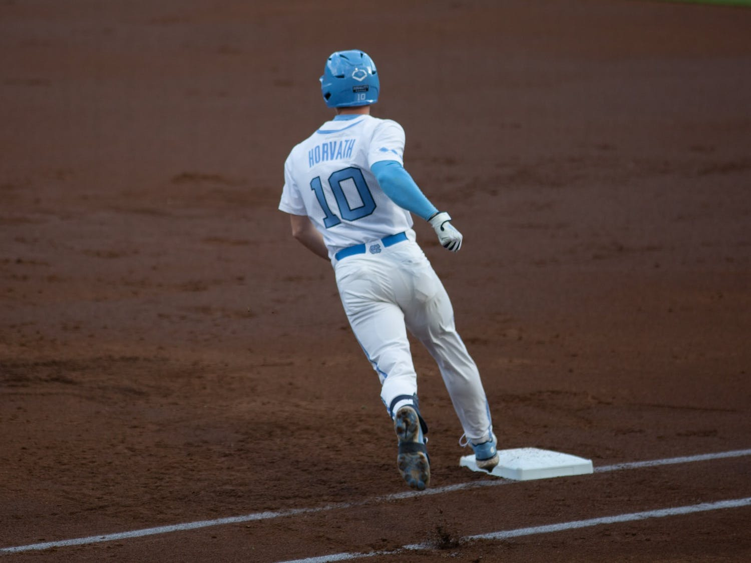 First-year infielder Mac Horvath (10) rounds first base after a home run in a game against Louisville on Friday, May 14, 2021. The Tar Heels beat the Cardinals 5-1.