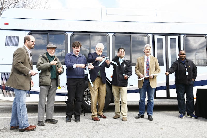 The Town of Chapel Hill unveils the 15 new hybrid-electric buses of its transit line. Chapel Hill Mayor Mark Kleinschmidt and Congressman David Price were two of the speakers at the event on Saturday afternoon at University Mall.From left: Assistant Transit Director Brian Lichtfield, Mayor Pro Temp Ed Harrison, Town Councilman Lee Storrow, Congressman David Price, Mayor Mark Kleinschimdt, Town Councilman Jim Ward and a CHT bus driver cut the ribbon to welcome in the new buses to the fleet.