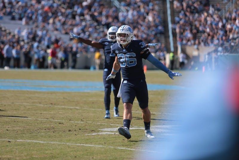 Carolina line backer Cole Holcomb (36) celebrates after a play
