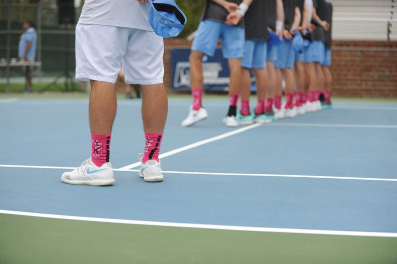 The UNC men's tennis team wears pink socks in support of senior Blaine Boyden's mother, Pam Boyden, and cancer survivors everywhere on Senior Day on Sunday, April 7, 2019. UNC won against Notre Dame 5-0.
