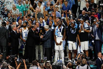 The North Carolina mens basketball team recieves the NCAA Final trophy after their win over Gonzaga in Phoenix on Monday.