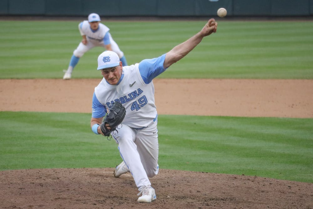 UNC junior pitcher Chris Joyner (49) pitches the ball during the Tar Heels' 1-6 loss against N.C. State on Saturday, March 27, 2021 in Boshamer Stadium in Chapel Hill, N.C.