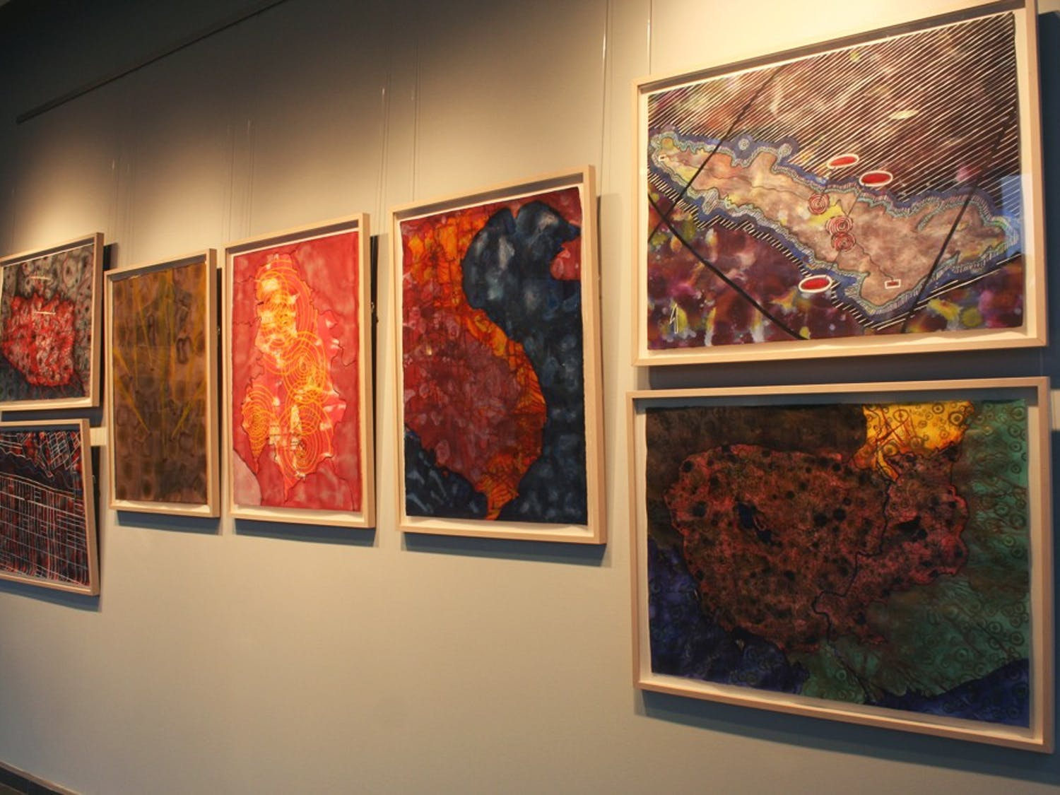 """elin o'Hara slavick's ink, watercolor, color pencil and gouache paintings are on display in the FedEx Global Education Center. They are part of the artist-professor's collection """"Protesting Cartography: Places the U.S. Has Bombed."""""""