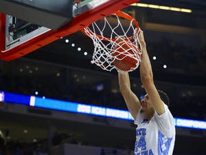 Sophomore Justin Jackson (44) dunks the ball during the ACC Tournament Championship game against Virginia on March 12.