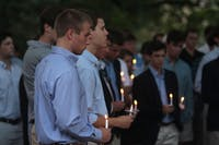 Friends and family of Harris Pharrgather Tuesday night for a candlelight vigil at the Old Well.