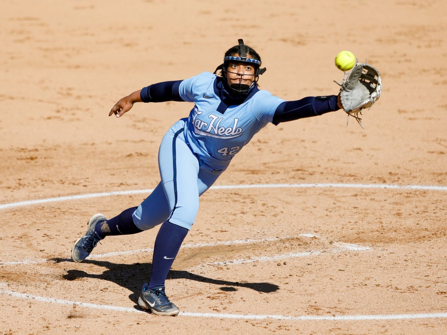 UNC junior pitcher Hannah George (42) attempts a catch in Anderson Softball Stadium in Chapel Hill, NC on Feb. 20, 2021. The Syracuse Orange beat the Tar Heels 3-2.