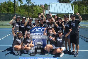 The UNC women's tennis team poses for a team picture after defeating the University of Miami 4-2 to capture the ACC Championship on Sunday in Cary.