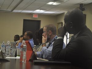 Members of the UNC System Campus Security Committee listen at a meeting on the Campus Security Initiative at the UNC System's office on Wednesday, Sept. 26.