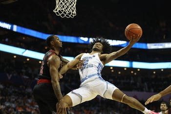 First-year guard Coby White (2) pushes pass defenders for a layup against Louisville in the quarterfinals of the ACC tournament on Thursday, March 14, 2019 at the Spectrum Center in Charlotte, N.C. UNC defeated Louisville 83-70 to advance to the semifinals.