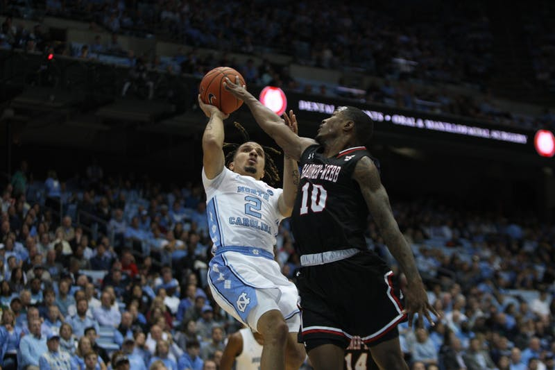 First-year guard Cole Anthony (2) fights for a two-pointer in the game against Gardner Webb on Friday, Nov.15, 2019 in the Smith Center. UNC beat Gardner-Webb 77-61.