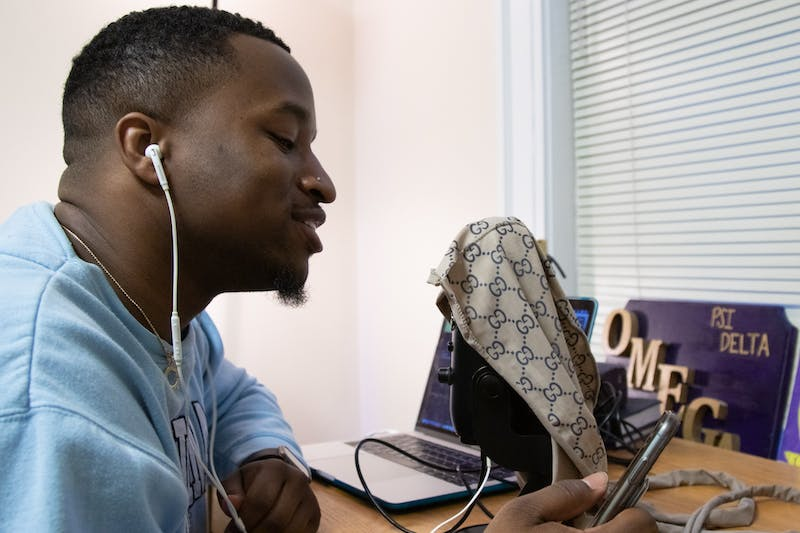 """Senior Greg Davis II, of Fayetteville, poses for a portrait on March 2, 2020. He records out of his dorm room and has started making noise in the UNC music scene. """"I just want to make music that people can have fun with"""" he said."""