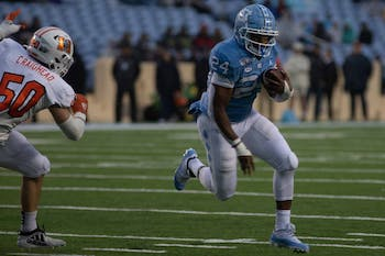 Senior running back Antonio Williams (24) runs down the field in Kenan Memorial on Saturday Nov. 23, 2019. UNC beat Mercer 56-7.