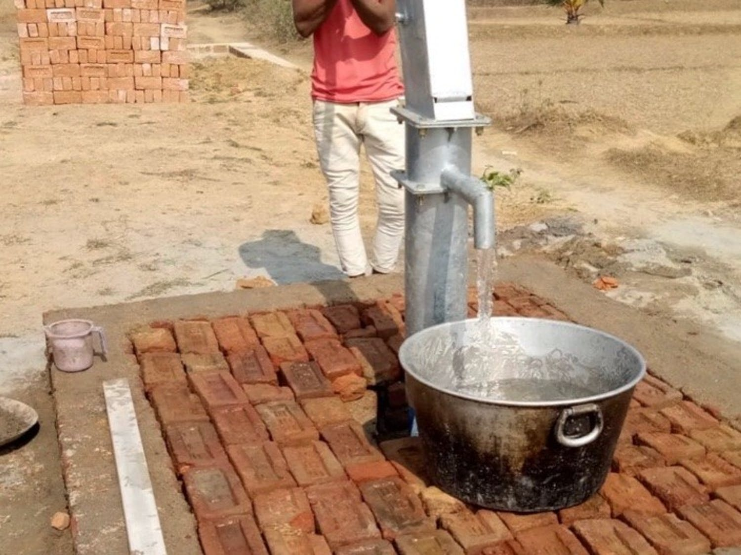 The hand pump installed through the efforts of the Healthy Hands Initiative in Lalpur. Photo courtesy of Jonah Im.