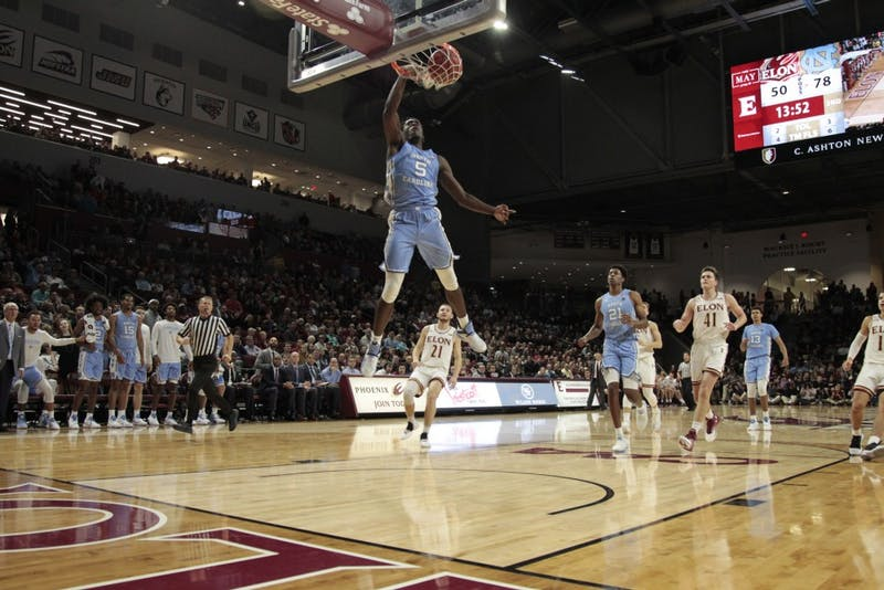 UNC first-year forward Nassir Little (5) dunks against Elon during the game on Friday, Nov. 9, 2018 at the Schar Center.