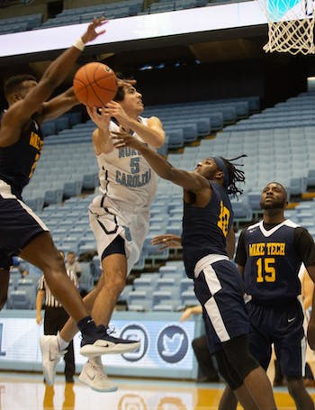 Anthony Perry (10) attempts to block Robbie O'Han (5) from making a basket against Wake Tech on January 15, 2019 at the Dean E. Smith Center. UNC JV won 80-64.