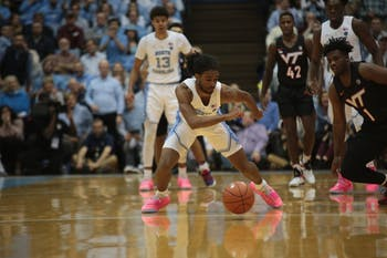 UNC first-year guard Coby White lunges for the ball during the first half against No. 10 Virginia Tech on Jan. 21 at the Smith Center.