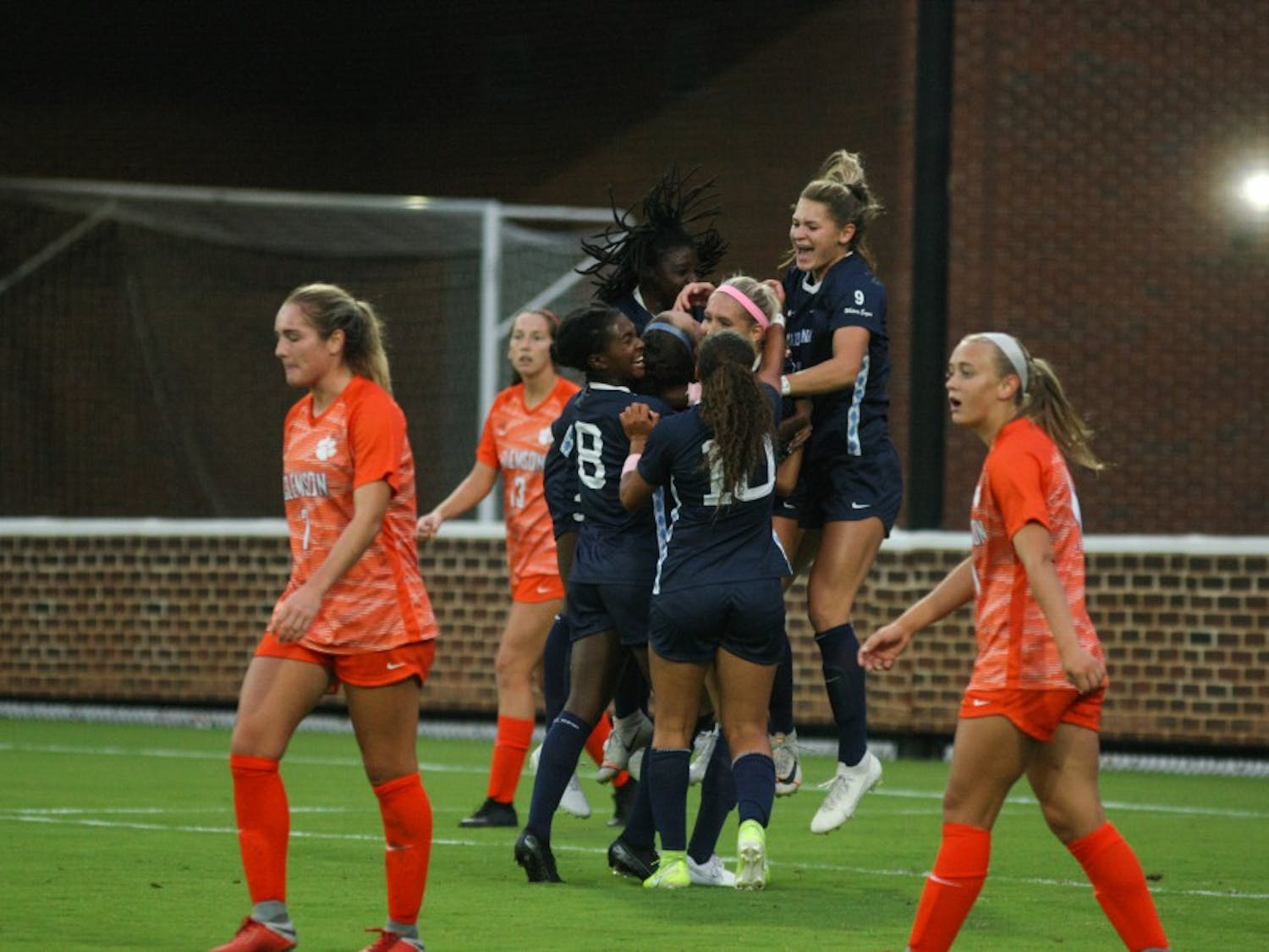The UNC women's soccer team celebrates a goal scored against Clemson during a game on  Saturday, Oct. 5th, 2019. UNC beat Clemson 1-0.