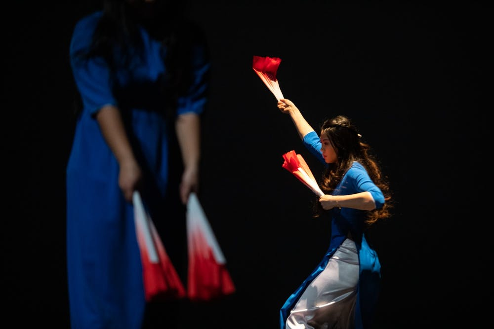 """A member of Blue Star performs a Vietnamese modern fan dance from a Vietnamese show called """"Paris by Night"""" at Memorial Hall on Saturday, Feb. 29, 2020."""
