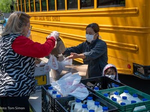 Food is bagged and loaded onto the school bus as part of the Food for Students Program. Photo by Tom Simon.