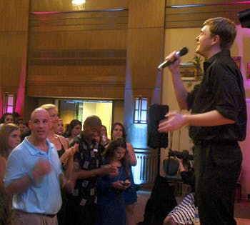 First-year Jack Hazan of the Walk-Ons sings acapella at the 2nd Annual Joy Prom on Thursday night at the Alumni Center.
