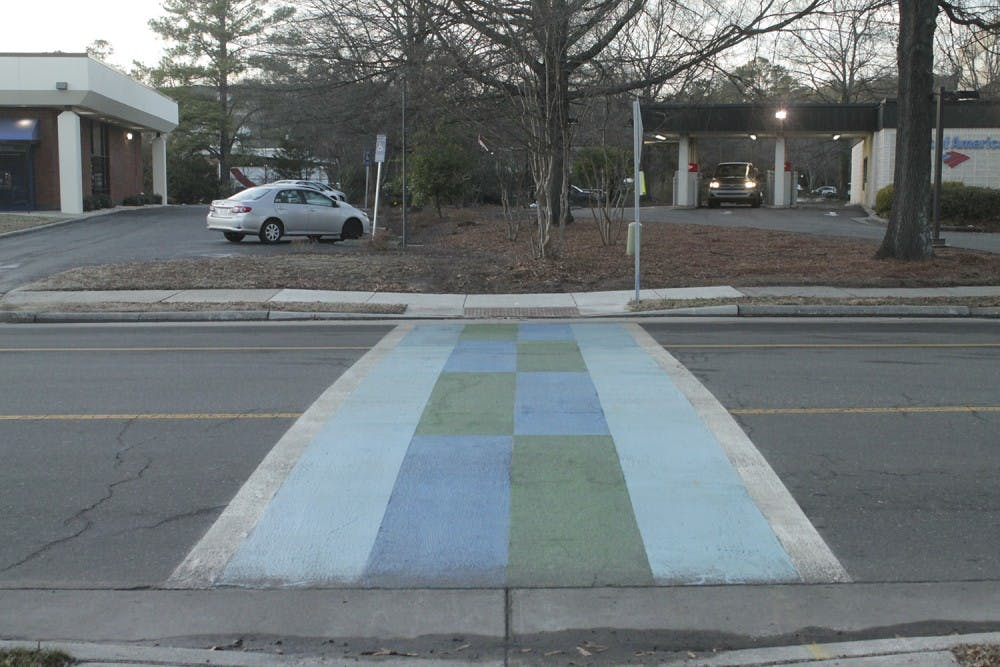 Local artists design colorful crosswalks to improve safety in town