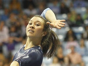 North Carolina senior Kristin Aloi performs in the floor exercise against N.C. State Sunday. UNC held off the Wolfpack for its first victory.