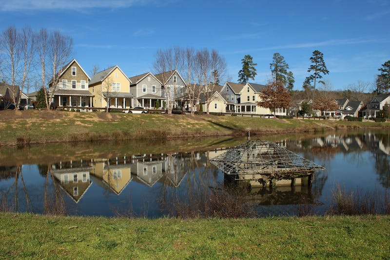 A row of houses on Hill Creek Boulevard, pictured on Tuesday, Feb. 18, 2020, sits next to a force main pipe that pumps sewage up toward the wastewater treatment plant in Chatham County. Briar Chapel residents are requesting neighborhood developers to reduce the odors and change the location of the wastewater treatment plant.