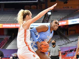 Jan 19, 2021; Syracuse, New York, USA; North Carolina Tar Heels center Janelle Bailey (44) looks to shoot as Syracuse Orange forward Digna Strautmane (45) defends in the third quarter at Carrier Dome. Photo courtesy of Mark Konezny-USA TODAY Sports