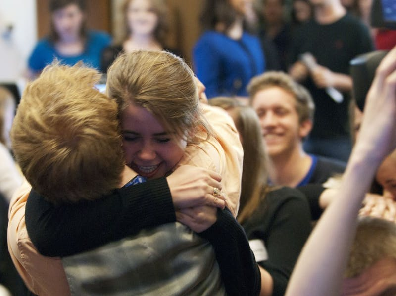 Student Body President-elect Mary Cooper hugs Walt Peters, one of her campaign managers, after the election results were announced.