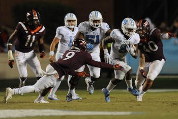 UNC tailback Michael Carter (8) carries the ball against Virginia Tech on Oct. 13 at Kenan Memorial Stadium.