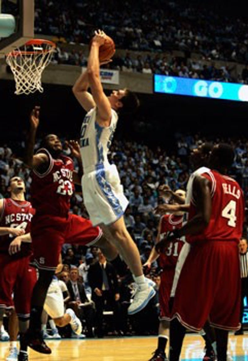 """Tyler Hansbrough scored 27 points as the Tar Heels burried the N.C. State Wolfpack 89-80 Wednesday night in Chapel Hill. It was Hansbrough?s 72nd game with 20 or more points"""""""" the most in NCAA history."""
