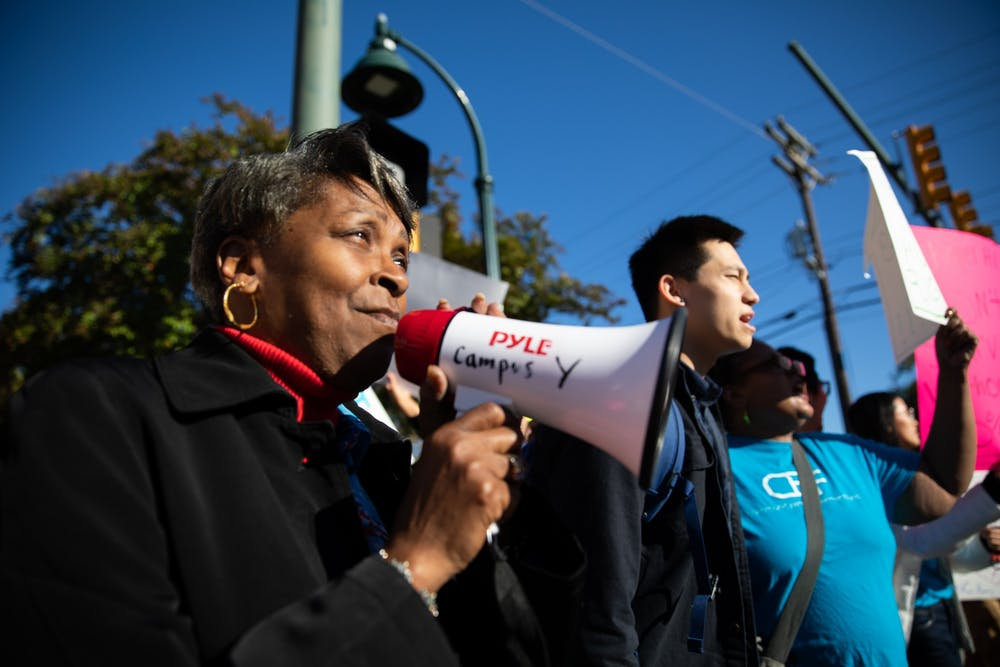<p>(From left) Yvete Mathews, 61, of Chapel Hill, and Tai Huynh, a junior computer science major, rally at a demonstration organized by Community Empowerment Fund calling for affordable housing accommodations for people at or below 30% AMI on Rosemary Street on Friday, Nov. 1, 2019.&nbsp;</p>