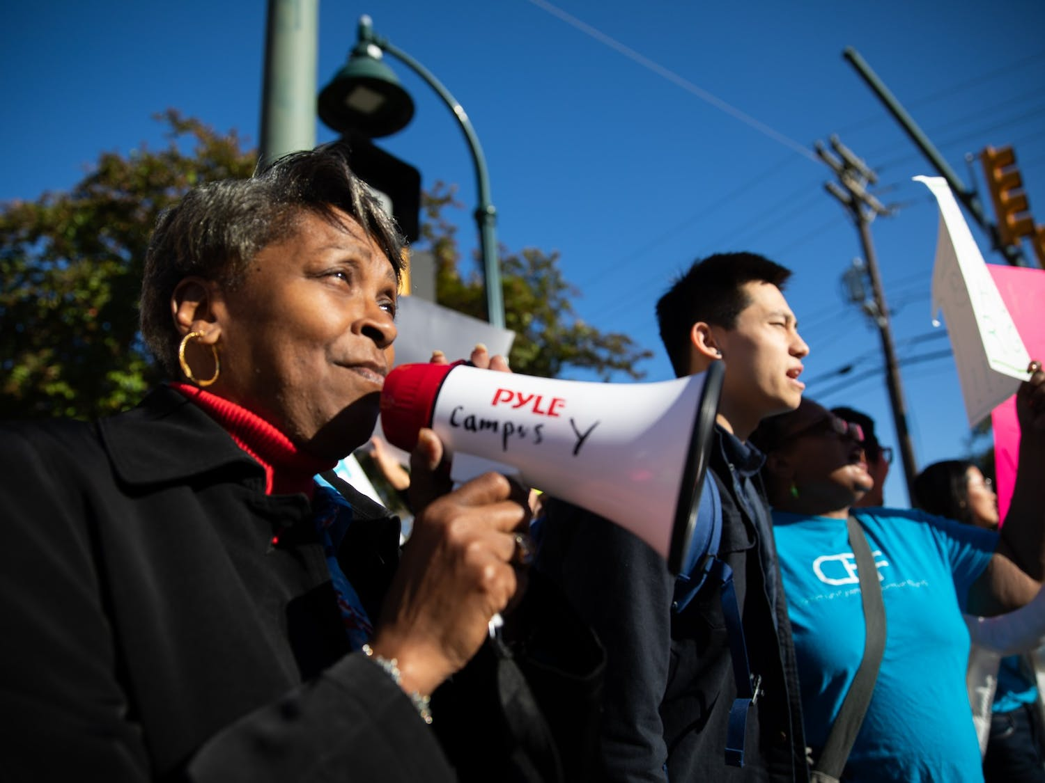 (From left) Yvete Mathews, 61, of Chapel Hill, and Tai Huynh, a junior computer science major, rally at a demonstration organized by Community Empowerment Fund calling for affordable housing accommodations for people at or below 30% AMI on Rosemary Street on Friday, Nov. 1, 2019.