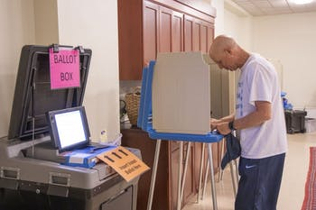 John Chandler, 58, of Chapel Hill, fills out his ballot for the local election at Chapel of the Cross on Wednesday, Oct. 23, 2019. Early voting for the Chapel Hill local election is available here on weekdays from 9 a.m. to 6 p.m. and Sunday, Oct. 27 from 12 p.m. to 4 p.m.