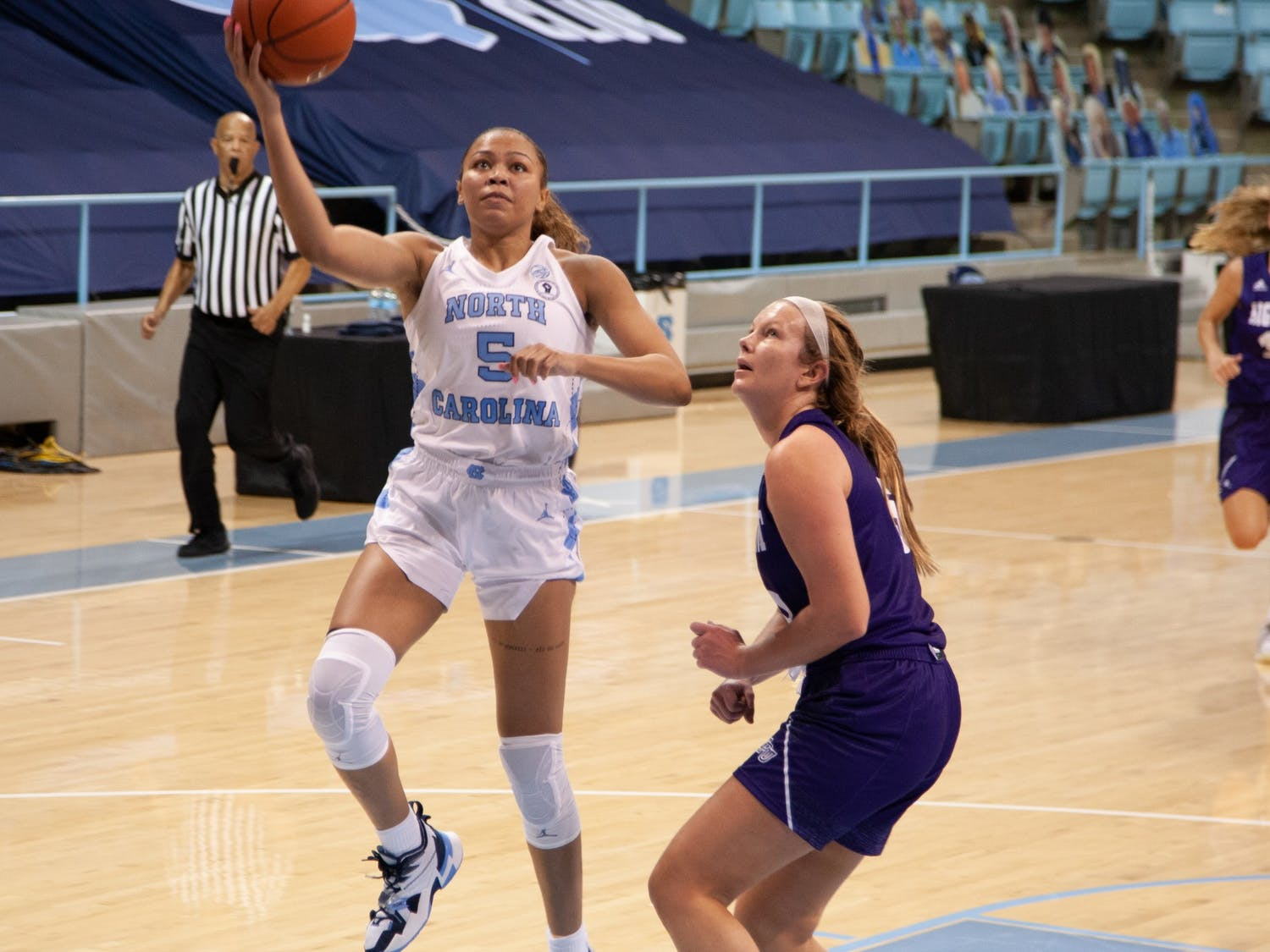UNC graduate student guard Stephanie Watts (5) goes for a layup during game against High Point on Sunday, Nov. 29, 2020 in Carmichael Arena.