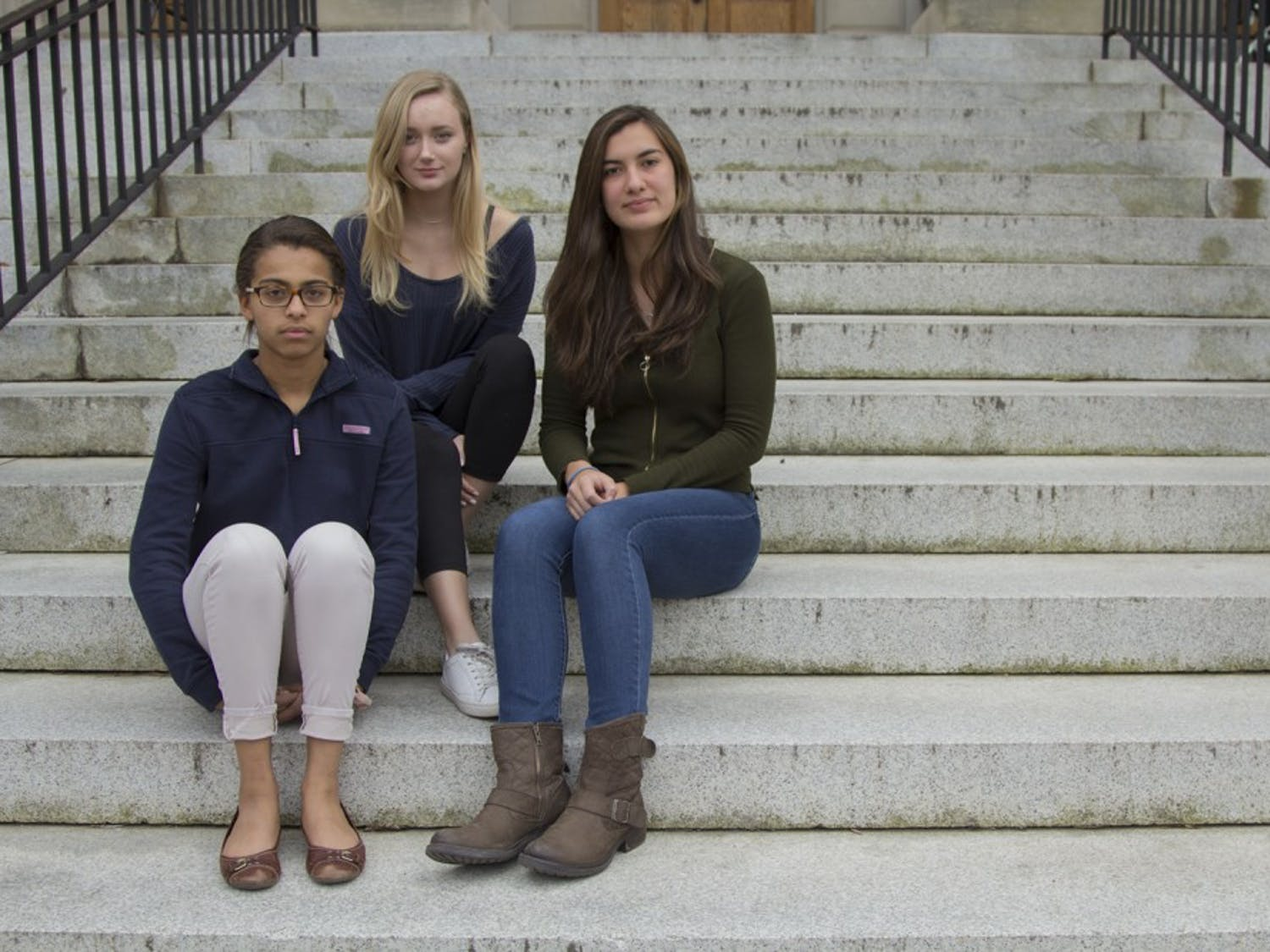 First-years Delainey Kirkwood (left), Charlotte Smith (middle), and Monica Mussack (right) are international students who attend UNC.