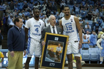 Head Coach Roy Willliams recived a a plaque on Monday, Dec. 30, 2019 after UNC's win against Yale. Williams' tied his number of wins (879) with former head coach Dean Smith.