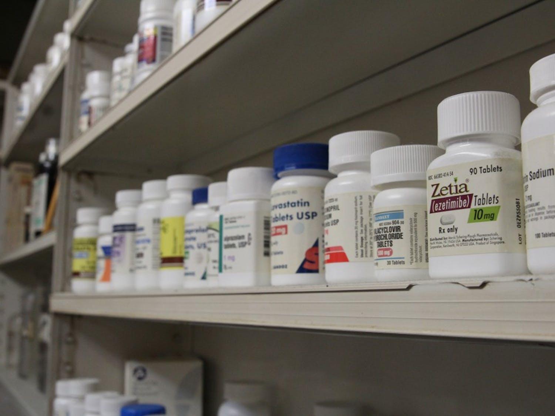 Pill bottles line the back shelves of Sutton's Drug Store on Franklin Street.