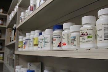 Pill bottles line the back shelves of Sutton's Drug Store on Franklin St.